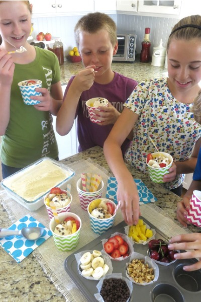 Throw a fun ice cream sundae party featuring this naturally-sweetened, homemade vanilla bean ice cream recipe. You and your kids (and their friends) will love it!