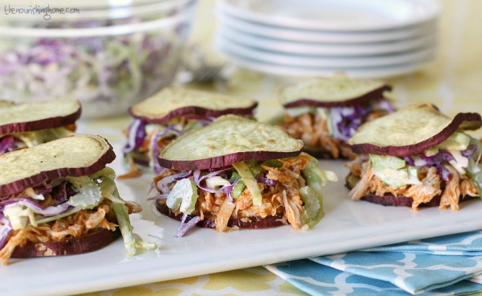 Whole30 Buffalo Chicken Sliders – moist, slow-cooked chicken smothered in a spicy, flavorful sauce piled onto tasty sSweet potato buns with crunchy slaw.