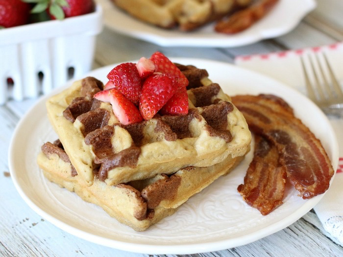 These delightful grain-free Cinnamon Toast Waffles pair beautifully with fresh ripe berries and just a drizzle of pure maple syrup!